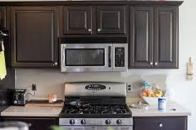 white kitchen cabinets with hexagon backsplash hexagon tile in the kitchen vintage revivals