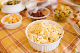 macaroni and cheese with butternut squash food above gold