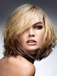 sliced layered chin lengt bob with bangs 20 brightest medium layered haircuts to light you up