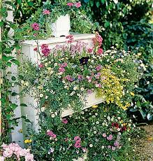 using recycled goods garden ideas for your own whimsical outdoor