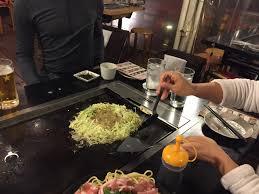 japanese restaurant cook at table japan okonomiyaki japanese cabbage pancakes traveling gem