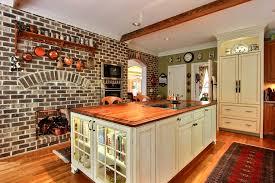 jamestown designer kitchens book cabinet kitchen traditional with brick arch wood countertop
