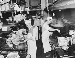 chefs at work in the kitchen of a restaurant in new york u0027s