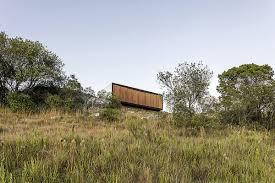 green prefab in uruguay redefines boundaries with minimalist approach