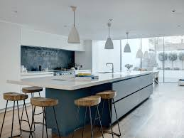 a bold blue u0026 white linear basement kitchen