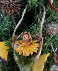 diy baby fairy in a milkweed pod swing http