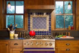 universal design in the arts crafts spirit arts crafts homes decorative tile collected in england became the centerpiece of the range backsplash