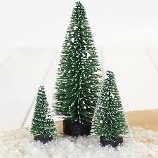 3 snowy bottlebrush trees on wooden bases pipii