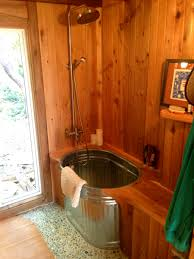 rustic metal tub suits this little cabin bathroom keva tiny house