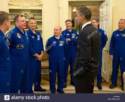u s president barack obama greets the space shuttle sts 132