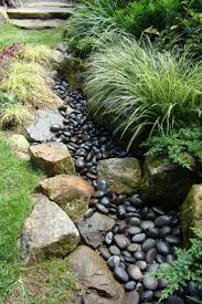 side hill landscaping front yard stones and little rocks need to
