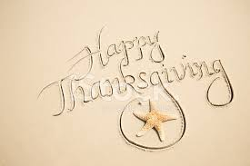 happy thanksgiving message in sand w starfish stock photos