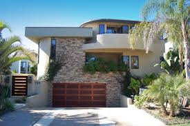 exterior design modern garage doors with balcony also driveway