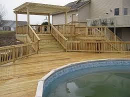 decorating ideas artistic round pool with brown wooden deck and