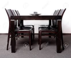 Modern Wooden Chairs For Dining Table Modern Wooden Finished Dining Table With Six Chair Set Stock Photo