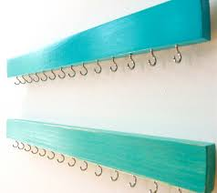 Jewelry Storage Solutions 7 Ways - wall jewelry organizer with ikea picture ledge on top for rings