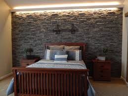 Bedroom With Accent Wall by Stone Accent Wall A Stone Accent Wall And Rustic Mantel Are