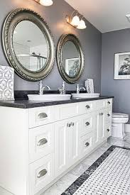 old farmhouse bathroom with white cabinets hole sink faucets