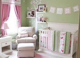 soft pink and mint green nursery decor for a baby in a bird