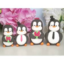 personalised penguin family wedding cake toppers with two kids