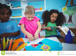 happy kids doing arts and crafts together stock photo image