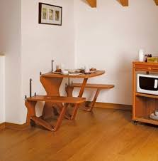 Triangle Dining Room Table Interior Brown Wooden Floor Brown Wooden Drawer Four Wooden Chairs