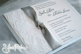 chagne satin ribbon simple band of lace framed by a knotted satin ribbon invite with