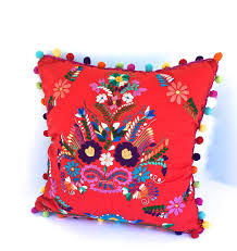 red embroidered mexican dress pillow with rainbow pom pom fringe