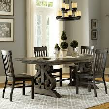 wood farmhouse dining table with carpets and curtains and grey
