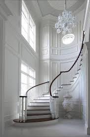 wall panel molding staircase traditional with oversized chandelier