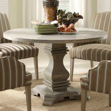 create a warm ambience with soothing rustic round dining table