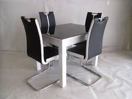 White Extending Dining Table And Chairs Black White Primo Extending Dining Table And 4 Chairs Sets