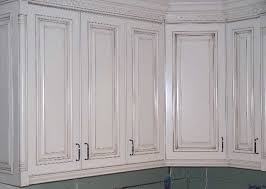 Paint Finishes For Kitchen Cabinets by Painted Cabinets With Glaze Rub Through