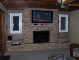 tv beside fireplace interesting interior impressive neutral stone
