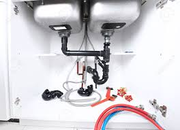 kitchen sink pipes and drain plumbing service stock photo