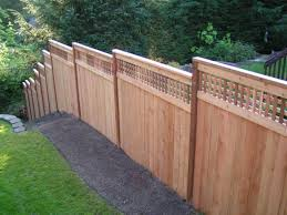 wooden fences on a backyard slope instructions to build fences