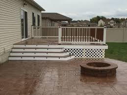 composite deck with wide stairs led lights stamped concrete and