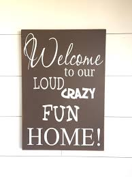 large wood sign welcome to our loud crazy fun home home