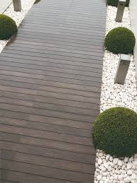 Light Up Topiary Balls - wooden decking pathway borders by pale gravel decorative chipping