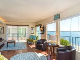 Living Room And Family Room by Large Bayfront Condo With Panoramic Beach A Vrbo