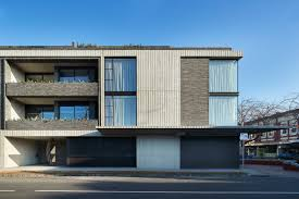 Concrete Apartments by Woods Bagot Combines Brick And Board Marked Concrete Throughout