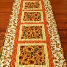 quilted batik table runner in tonga spice from susiquilts on etsy