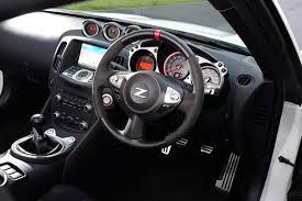 370z Nismo Interior Peugeot Rcz R Vs Nissan 370z Nismo Pictures Peugeot Rcz R Vs
