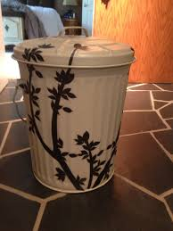 took a metal trash can painted it with the exterior trim of our