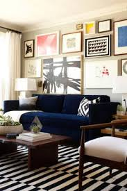 Black Sofa Interior Design by How To Make Your Home Look Expensive On A Budget The Everygirl