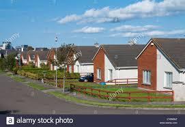 row of bungalow houses on a suburban estate street uk stock photo