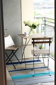 Make Your Own Outdoor Rug Feminine Chicago Condo Tour Tiny Balcony Outdoor Rugs And