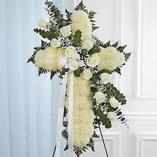 sympathy flowers white prayers cross flowers expo florist of riverside