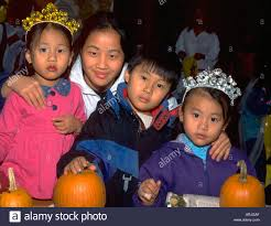 asian american family in costumes at youth express halloween party