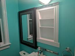 i made a recessed medicine cabinet hidden behind a sliding mirror